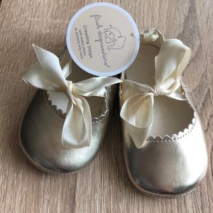 Gold soft soled baby shoes by First Impressions